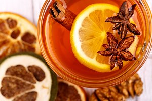 Cup of tea with cinnamon and lemon