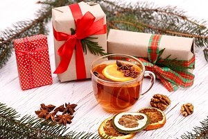 Cup of black tea and gift boxes