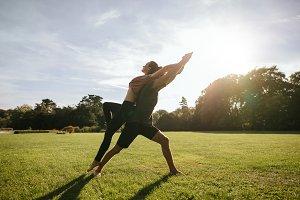 Couple doing acrobatic yoga