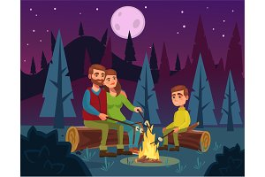 Family picnic by fire at night
