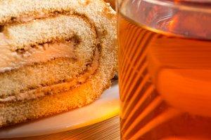 Brown sponge cake and mug of tea