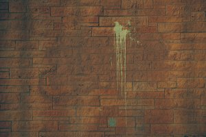 Brick Wall with Paint Splatter