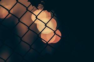 Bokehs Through a Fence