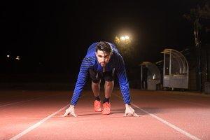 Athlete runner sprinter start, night