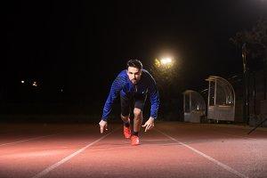 Man sprinter, start, night dark