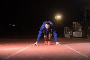 Runner sprinter start position night