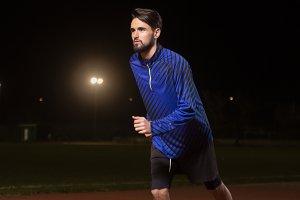 Runner, running tracks, night dark