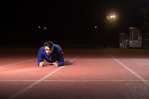man athlete plank night