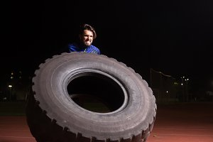 athlete tire exercise outdoors night