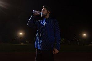 Man drinking water, athlete night