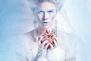 Snow queen with heart in hands