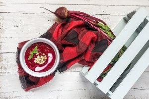 beet soup in a white bowl