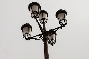 Black streetlight with five lamps