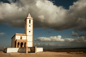 Amazing clouds over a white church