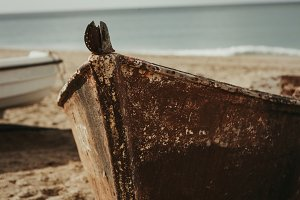 Old boat on the sand of the beach