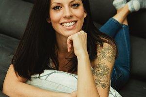 Pretty brunette woman at home