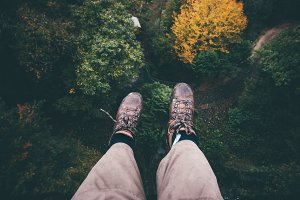 Feet selfie on cliff forest aerial