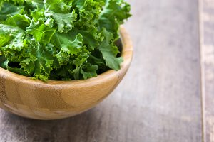 Fresh kale in a wooden bowl