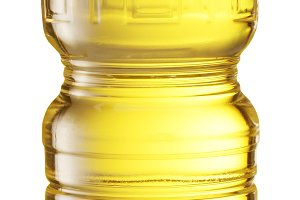 Cooking oil in a plastic bottle on a white background.