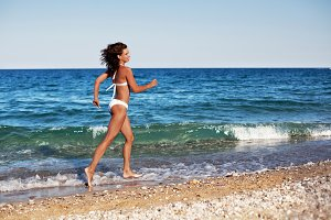 woman in white swimsuit running