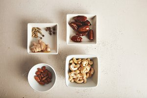 Nuts and dried fruits in small bowls