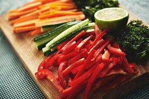 Cut fresh vegetables on a wooden board