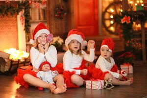 Christmas kids, three sisters & doll
