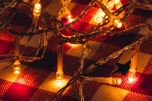 garland lights in the background of a checkered tablecloth