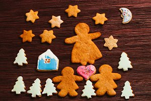gingerbread cookies in glaze on a dark wooden background