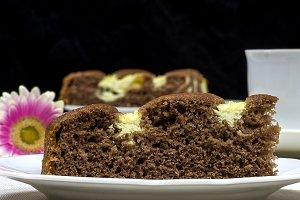 Homemade cocoa cake with cream