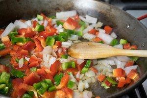 preparation step of a chicken paella
