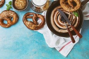 Fried sausage with beer and pretzels