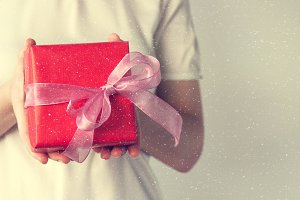 Holiday concept with holding gift
