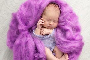 Newborn in pink wool