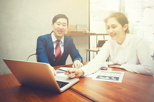 Business man and Business woman having discussion in business meeting- Business meeting and Diverse teamwork concept