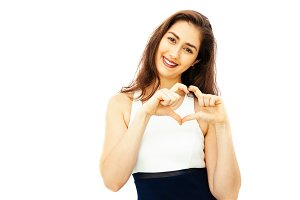 Beautiful woman making hands gesture in heart shape with copy space - Valentine's day and Love concept