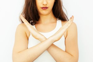 Closeup of Beautiful young Caucasian woman in smart casual dress say no with crossed arms hands