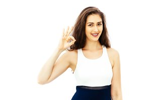 Beautiful young Caucasian woman in smart casual dress giving ok sign gesture with copy space on isolated white background