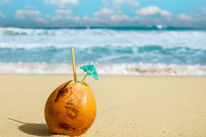 Coconut water nut on the beach.