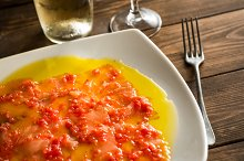 Salmon carpaccio with olive oil