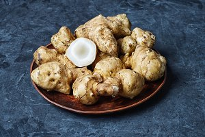 Jerusalem artichokes on dark background