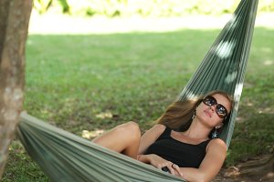 woman with sunglasses resting