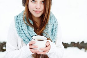 Young attractive woman drinking tea