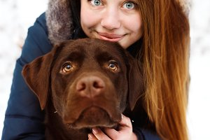 Young woman with labrador dog