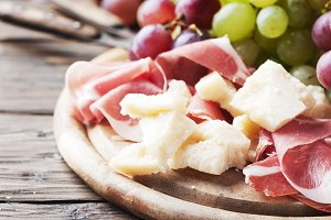 Antipasto with grape, cheese and ham