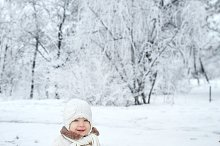 Baby in winter forest