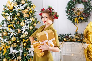 Girl holding Christmas gifts