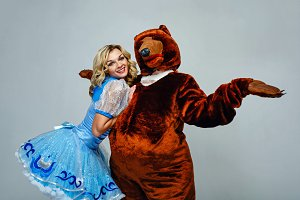 Attractive young girl and bear