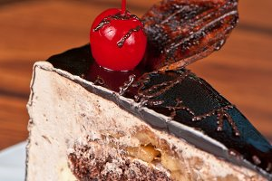 tasty piece of cherry cake closeup