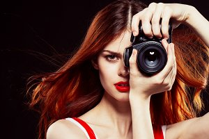 beautiful young girl with a camera